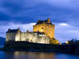 Eilean Donan Castle Floodlit Against Deep Blue Twilight Sky and Water of Loch Duich  Near Dornie  K
