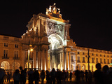 Silhouetted People on Praca Do Comercio under the Illuminated Rua Augusta Arch at Night in Central
