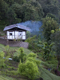 Traditional Small Bhutanese House with Smoke Coming from Roof from Open Fire Inside  Near Trongsa