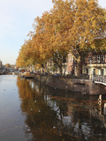 Autumnal Leaves Reflect in the Water of a Canal in Central Utrecht  Utrecht Province  Netherlands
