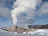 Castle Geyser Erupting in Winter Landscape  Yellowstone National Park  UNESCO World Heritage Site