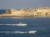 Fort Ricasoli from Valletta  with Yacht and Water Taxi Passing  Malta  Mediterranean  Europe