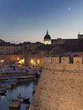 Dubrovnik Old Town Port with the Dome of the Cathedral Illuminated at Dusk  UNESCO World Heritage S