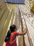 Woman in Sari Checking the Quality of Freshly Dyed Fabric Hanging to Dry  Sari Garment Factory  Raj