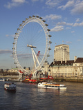 Cruise Boats Sail Past County Hall and the London Eye on the South Bank of the River Thames  London