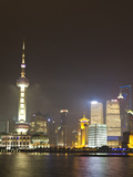 Pudong Financial District and Oriental Pearl Tower across the Huangpu River  Shanghai  China  Asia