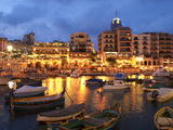 Evening across Spinola Bay with Restaurants  St Julian`S  Malta  Mediterranean  Europe