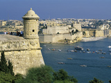 View over Bastions and Grand Harbour to Fort St Angelo with Rowing Regatta  Valletta  Malta  Medit