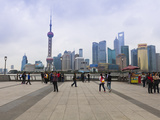 Pedestrians and Tourists on the Bund  the Futuristic Skyline of Pudong across the Huangpu River Bey