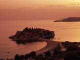 Sunset over Island of Sveti Stefan  Sveti Stefan  the Budva Riviera  Montenegro  Europe