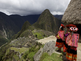 Traditionally Dressed Children Looking over the Ruins of Machu Picchu  UNESCO World Heritage Site