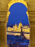 Parliament (Orszaghaz) Through Arches of Fishermen's Bastion (Halaszbastya) at Dusk  UNESCO World H