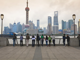 People Viewing the Pudong Skyline and the Oriental Pearl Tower from the Bund  Shanghai  China  Asia