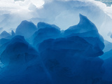 Midday Sun Lights Melting Iceberg Near Face of Eqip Glacier Along Disko Bay  Ilulissat  Greenland