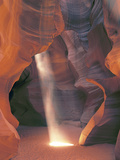 Sunbeam Illuminates Sandy Floor and Sandstone Walls of a Slot Canyon  Antelope Canyon  Page