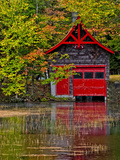 Old Forge Red Boathouse on Lake Shore  New York  Usa