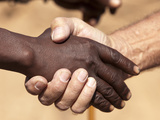 Black and White Male's Handshake  Opuwo  Namibia  Africa