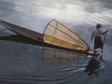 Intha Fisherman Rowing Boat with Fishing Net on Inle Lake  Myanmar  Asia
