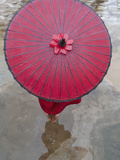 Novice Monk Holding Alms Woks with Red Umbrella  Bagan  Myanmar