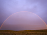 Rainbow Forming at Sunrise Above Arid Pampas Grassland Steppe