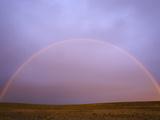Rainbow Forming at Sunrise Above Arid Pampas Grassland Steppe