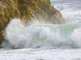 High Tide Surf Wave Crashing on Coastal Rocks and Beach in Winter