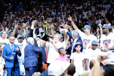 Miami  FL - June 21:  Team owner Micky Arison of the Miami Heat holds up the Larry O'Brien Champion