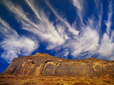 Clouds Hover Above a Sandstone Wall Along the Colorado River