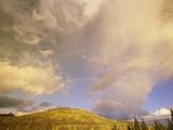 A Rainbow Shows Through Cumulus Clouds over the Mackenzie River Valley