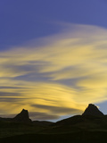 Mountain Peaks in Blue Sky and Colorful Lenticular Clouds at Dusk