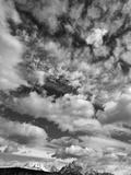 Cumulus Clouds Above Arid Pampas Steppe and Mountain Range Papier Photo par John Eastcott & Yva Momatiuk