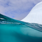 Floating Iceberg and Cumulus Clouds  Seen from Water's Surface