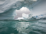 Floating Icebergs  Ice Arch and Sea Waves Seen from Water's Surface
