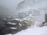 Villagers Head for Cover from High Seas and Blowing Snow