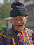 An Old Man at Trashigang Wearing the Traditional Gho Robe of All Bhutanese Men