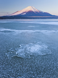 Ice on Lake Yamanaka with Snowcovered Mount Fuji in Background  Japan