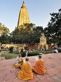 Monks Praying at the Buddhist Mahabodhi Temple  a UNESCO World Heritage Site  in Bodhgaya  India