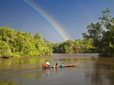 Venezuela  Delta Amacuro  Orinoco Delta  Warao People in Boat on Nararina River with Rainbow in Sto