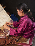A Woman Weaves an Intricate Pattern in Silk on Her Traditional Wooden Loom  Named 'Backstrap Loom'