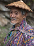 A Wizened Old Farmer Near Mongar Wears the Traditional Knee-Length National Robe Called Gho and a B