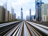 Opened in 2010  the Dubai Metro  Mrt  in Motion Along Sheikh Zayed Road at Dusk  Dubai  United Arab