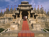 India  Rajasthan  Ranakpur  a Couple Descend Steps at the Famous Chaumukha Mandir  an Elaborately S