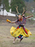 A Dancer Performs Shazam Tam  Dance of Four Stags Outside Punakha Dzong  Dance Commemorates the Sub