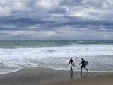Surfers on Grande Plage Beach  Biarritz  Aquitaine  France