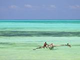 Tanzania  Zanzibar  Unguja  Jambiani  a Man Sits on His Boat Near the Shore