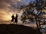 Two Maasai Men Silhouetted on a Hill at Sunset