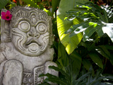 Bali  Ubud  a Stone Carving  Adorned with a Hibiscus Flower  Sits in Tropical Gardens