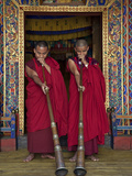 Two Monks Blow Long Horns Called Dung-Chen  at the Temple of Wangdue Phodrang Dzong (Fortress)