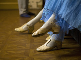 StPetersburg  Russia  Detail of Ballerinas Shoes and Dress During a Short Rest Backstage During th