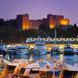 Palace of the Grand Masters and Mandraki Harbour Illuminated at Dusk  Rhodes Town  Rhodes  Greece